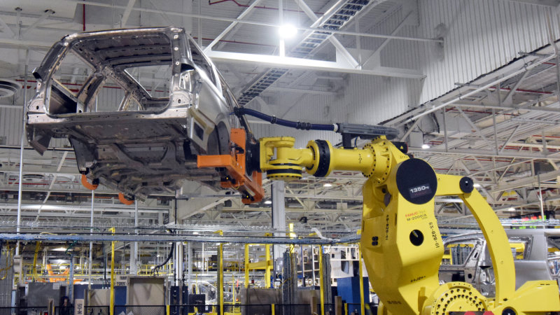 Automakers are hiring more people, despite automation robots